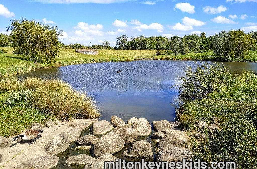 Ashland Lakes In Milton Keynes with stones in front