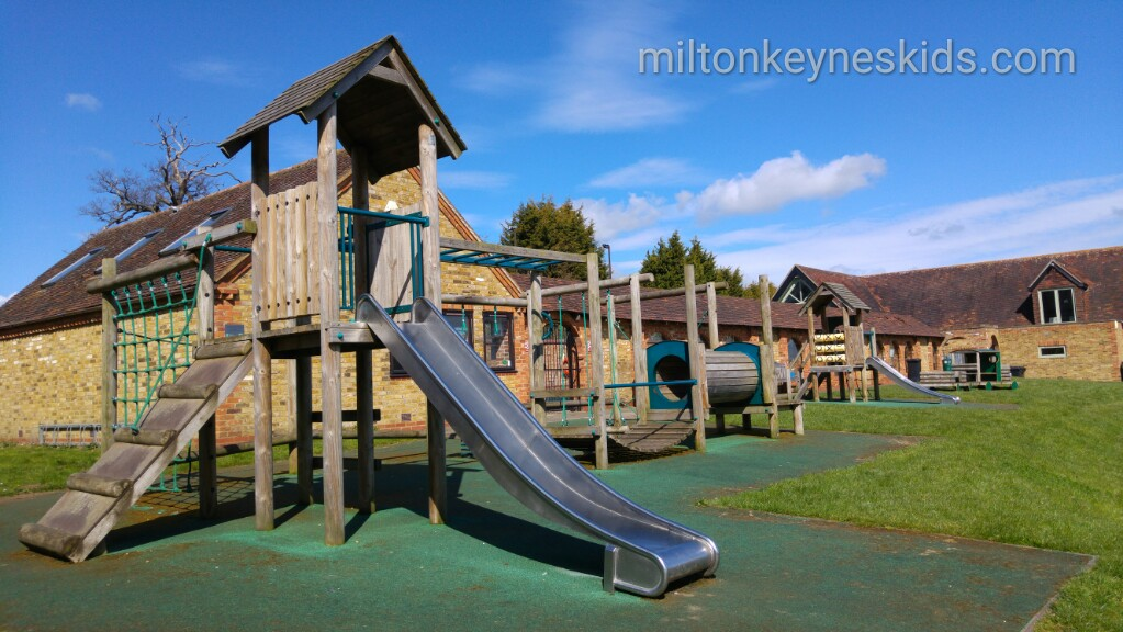 Eversholt park with fun wooden play equipment next to Eversholt swimming pool in Bedfordshire