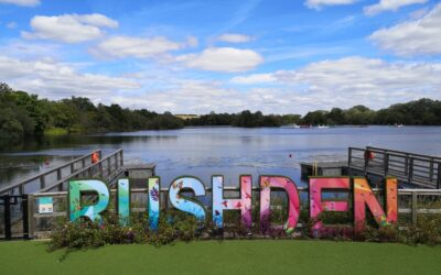 Rushden Lakes sign in front of the lake