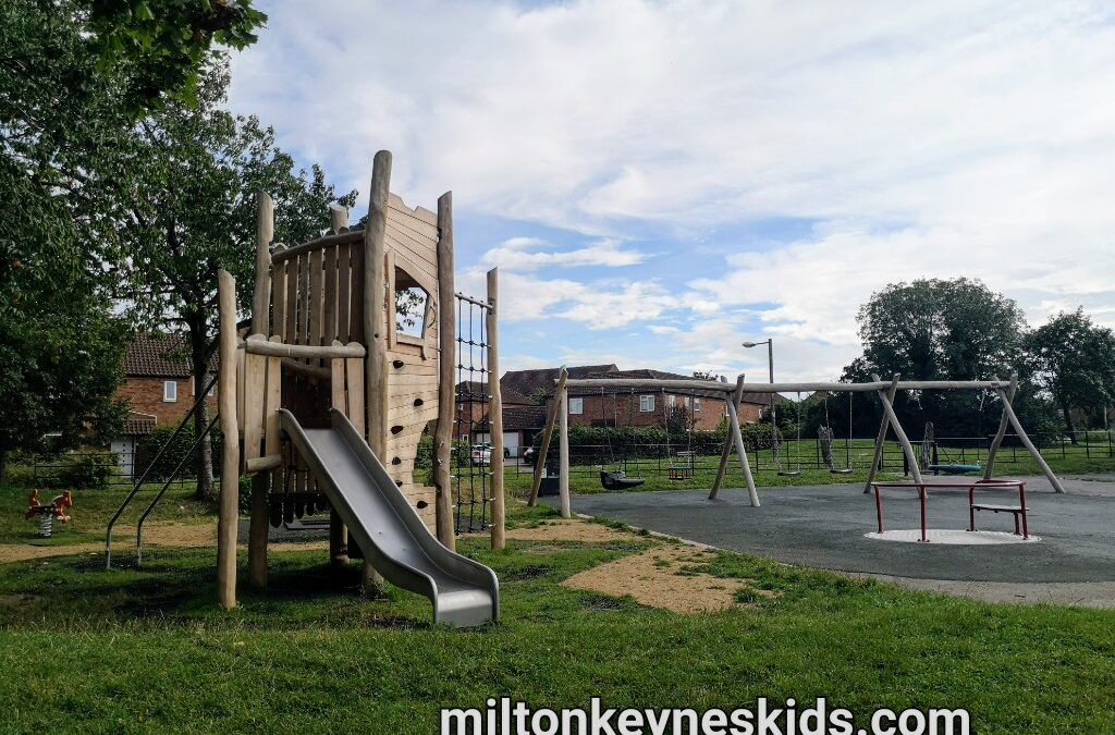 Climbing frame and swings at Serjeants Green play area, Neath Hill